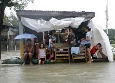 aftermath of typhoon in the philippines - missionaries from 1986 to 2003 } {