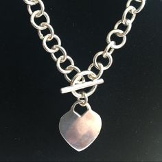 Silver heart necklace Replica of a Tiffany necklace.  You have a heart that's engrave-able heart or leave plain.  Nice weight.  Really nice Sears Jewelry Necklaces