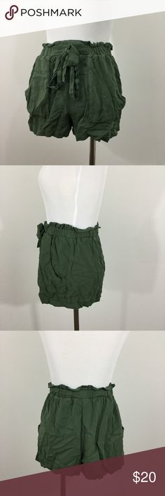 Army green high waisted shorts w cinched bow belt High waisted shorts with ruffled, cinched waist. This pair of super soft army green pants features pockets and an attached belt that can be secured in a bow. The perfect summer staple shorts. (I apologize for the wrinkles! I will be steaming them before shipping them to their new owner!) These have been tried on, but never worn! New condition! Shorts