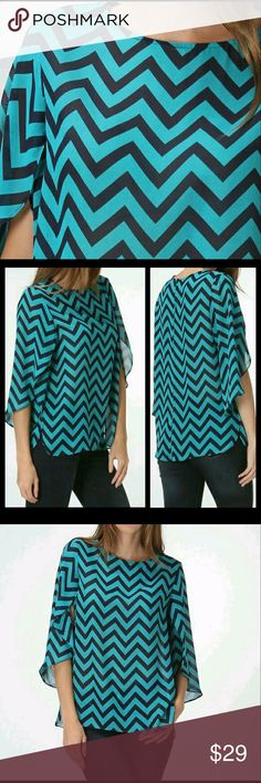 "⏬ Chevron Blouse Brand new! Excellent condition.  Navy and teal Chevron print with tulip style sleeve. Flows and lightweight.  Brand new.  Measurements: Size large: length: 25"", Bust: 21.5""   Material: 100% polyester. Bellino Clothing Tops Blouses"