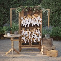 When it comes to escort cards, paper isn't your only option. At this Provençal reception designed byJesi Haack, escort cards were tied to individual baguettes, then displayed in an antique hutch that JL Designs decorated with greenery and potted herbs.Related: 75 Ideas for a Rustic Wedding