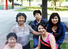 """I love Calgary, everything about it,"" says Sharon Chaw, pictured second from the left wearing a striped shirt. ""The white people here are so nice and helpful. Even though I have been here for what seems like forever now, my English is still terrible. But people seem to always try their best to understand what I am saying and take their time with me."" #YYCFaces #YYC #Calgary #AB (Photograph by Ariel Guimond)"