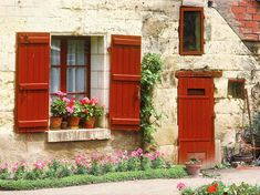 European photo of white stone cottage with red door and shutters in Cheonceau(Loire Valley), France by Dennis Barloga Red Shutters, Window Shutters, Window Boxes, Camping France, French Cottage, Cozy Cottage, Jig Saw, Loire Valley France, Storybook Cottage