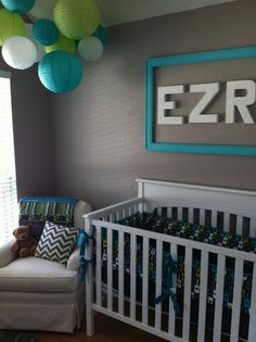Love the idea of the frame around the name on the wall.  Good colors too.