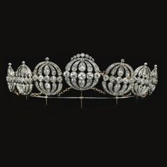 Tiara, c. 1810-1820.  Group of seven diamond jewels of historical importance, circa 1810-1820. Each oval open work plaque set with circular cut, old mine and rose diamonds, together with a tiara frame and later chain links, mounted in silver and gold together with other items relating to Mrs. Fitzherbert, George IV's first wife.  See also Off The Frame board