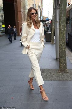 She sure knows how to strut! Australian supermodel Elle Macpherson was a vision in cream as she cut a youthful figure exiting the Channel Seven studios in Martin Place on Tuesday