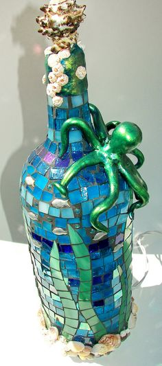"""Octo-Bottle"" recycled light Made from a recycled wine bottle, stained glass, shells, beads, polymer clay by Sharon Kelly of Glass Garden Creations"