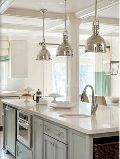 Silver industrial pendants, coffered ceilings, painted island, color blocked drapes
