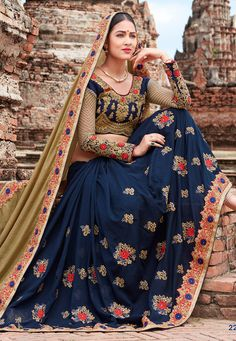 Faux Chiffon Half and Half Saree in Beige and Navy Blue This Eye Captivating Drape is Emblazoned with Resham, Zari, Stone, Dori and Patch Border Work Available with a Semi-stitched Raw Silk and Net Blouse in Navy Blue and Beige. Crafted in Round Neck. Blouse Length- 13 to 14 inches and Sleeve Length- 18 to 19 inches Free Services: Fall and Edging (Pico) Do note: Accessories shown in the image are for presentation purposes only.(Slight variation in actual color vs. image is possible).