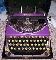 I have never seen a purple typewriter before. This is super rare.