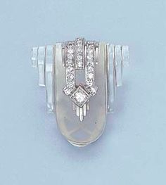 AN ART DECO ROCK CRYSTAL AND DIAMOND CLIP BROOCH, BY CARTIER Of shield shape, the frosted central section with diamond triple-line and collet detail to the stepped polished sides, circa 1930, 2.7 cm. high, with French assay mark for gold, with Cartier red leather case Signed Cartier Paris, no. 7023