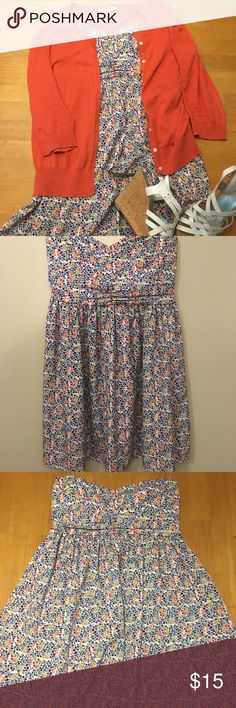 Forever 21 strapless floral mini orange/blue/white Forever 21 floral strapless mini / Size L / Gently used / white background with tiny floral detailing / orange, yellow, purple, blue, green / Rubber lining on bust / elastic on back / 100% polyester Forever 21 Dresses Strapless