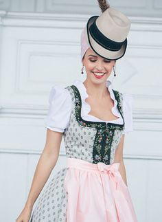 Black and white patterned dirndl with pink apron