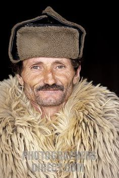 romanian shepherd in traditional clothing including a big heavy sheeps fleece