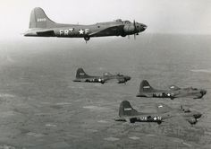 B-17s from the 524th and 525th BS, 379th BG in formation.BFD