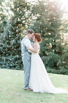 Wedding photography idea - bride + groom with falling flower petals {B. Jones Photography}