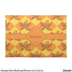 """Autumn Color Block and Flowers Cloth Placemat  Diamond checks in yellow and orange with matching fractal blooms, a center stripe and matte for text. The text shown is """"Welcome"""" - but you can replace that with your own, clear it out, or click on the """"Customize it!"""" button for more advanced option, to adjust the font size, type, color, or to add images, etc."""