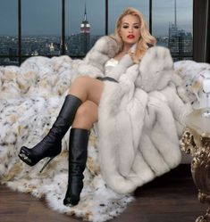 Image may contain: one or more people White Fur Coat, Fox Fur Coat, Fur Coats, Sexy Boots, Black Boots, American Express Gold, Fur Fashion, Womens Fashion, Fur Blanket