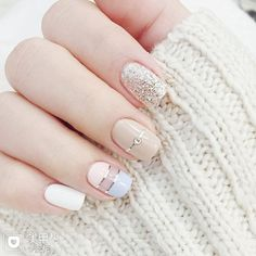 Light colored nails with striping tape and glitter accents. ― re-pinned by Breanna L.
