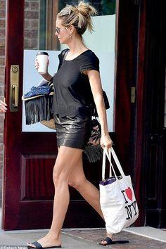 Heidi Klum wearing Saint Laurent Fringed Straw Tote and Saint Laurent Monogram Sunset Fringe Bucket Bag