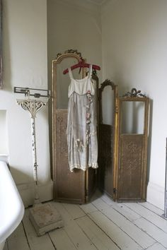 I am hanging my grandmothers slip up like this as part of my bedroom decor when I move, love it...