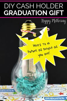 """Learn how to make a unique Light Bulb Cash Holder in our easy step by step tutorial. This creative DIY cash gift idea is a fun homemade present for high school or college graduates. A craft light bulb contains the dollar bill (denomination of your choice) and includes a free printable label that reads, """"Here's to a future that's as bright as you are!"""" #graduationgift #diygift #cashholder #graduation #graduationideas #howto #diy #lightbulbcraft #cashgifts #homemadegiftideas #crafts… Rainy Day Crafts, Fun Crafts For Kids, Craft Activities For Kids, Craft Stick Crafts, Preschool Crafts, Best Graduation Gifts, Graduation Diy, Gift Tags Printable, Free Printable"""