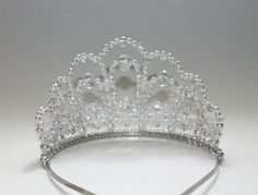 This tiara is meant for the true diva. The tiara measures 3 inches or 8 cm tall and is adorned with 74 crystal AB in various sizes. This tiara REALLY sparkles! This tiara is sent to you an a keepsake box. Common Questions Can small children wear this tiara? Yes. I have used a