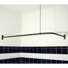 Problem Solvers: 10 Uniquely Shaped Shower Curtain Rods new curtain rods in all bathrooms?