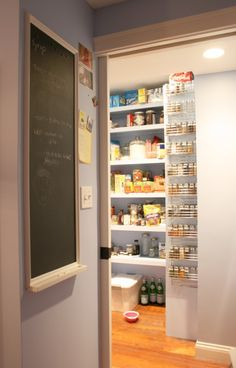 Love the shelves, bright, light colors, etc. of this pantry.