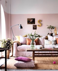 [This room looks as though it belongs with the room I just saved, with the mauve chair and books covered in pink, lavender, and peach. That room has a different wall color, but I wouldn't be surprised to learn that it's adjacent to this one.]  Sweetness of pastels balanced by touch of global influence
