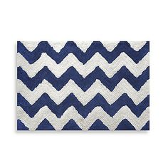 Make your bathroom floor safe with this beautiful bath rug. Features a stylish zig zag pattern in navy and white. Measures 20 L x 30 W.