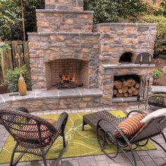 Outdoor fireplace with pizza oven and log storage... I'd forego my fire pit dream for this instead...ha ha ha.