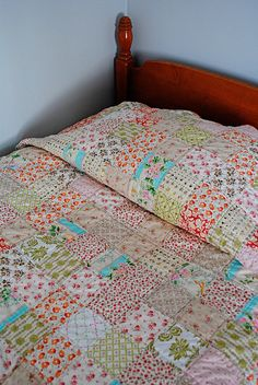 Love the ditzy prints of this quilt. Simple pattern made dynamic with the top stitching on either side of every seam. Wonder if I could do that with a double needle and make life easier on myself?