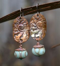 Earrings by Kristi .These could be done in polymer clay