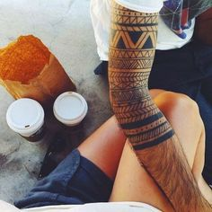 Samoan adapted sleeve tribal tattooThe geometric patterns of Samoan tattoos are widely used in the masculine tattoos for men.