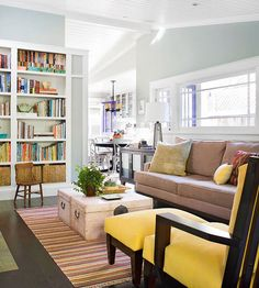Family-Friendly Storage - love the bookcases! #storage #bookcase #living room