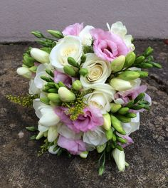 Fresh Spring bouquet with freesias roses and lisianthus.