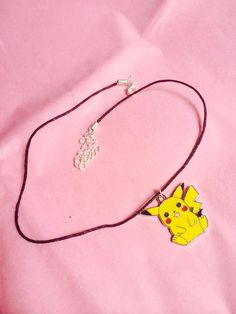The choker is made personally by myself. It consists of a black cord choker (1mm) with an enamel Pikachu charm (24mm) on the center. The choker