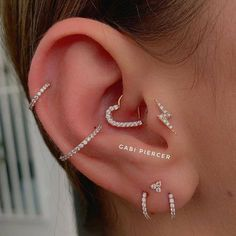 Bodysuit tattoos aro tragus tragus piercing jewelry percing tragus t Pretty Ear Piercings, Ear Peircings, Multiple Ear Piercings, Tragus Piercing Jewelry, Tragus Piercings, Body Piercings, Tragus Stud, Heart Piercing, Ear Piercings