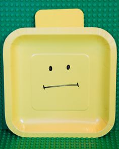 Lego minifigure head plates...each had a  different fun face.