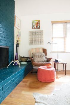 Very bold turquoise brick fireplace. Laura & Ray's Art-Filled Austin Home