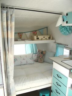 cozy bed area in campervan