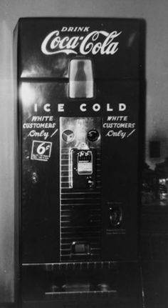 White only Coke machine.This coke machine was in a corner store in Jackson, Tennessee in 1943.