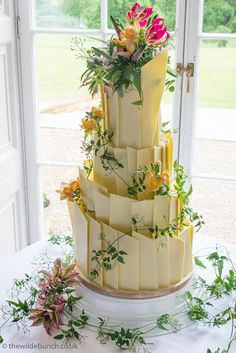 Wedding cake decoration at North Cadbury Court. Tropical summer styles using yellow flowers, pink dwarf pineapples, Jasmine trails and firery pink Gloriosa Lilies. A Wilde Bunch design. Cake Flowers, Wedding Cakes With Flowers, Gloriosa Lily, Country House Wedding Venues, London Bride, Lily Wedding, Wedding Cake Decorations, Summer Styles, Dwarf