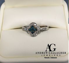 50% OFF! 14K White Gold Blue & White Diamond Ring. Diamond weight is 0.25 ct. t.w. Original Retail Price: $950.00 SALE PRICE: $475.00. | Call Andrew Gallagher Jewelers at 302-368-3380 for more information. We SHIP!! | #50OffJewelryCase