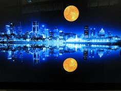3d. One of many 'scapes' I moonlit. This is Montreal's waterfront at night with my moon inserted. It could be used as a promotional travel destination ad for Montreal.