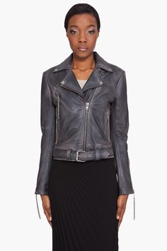 MAISON MARTIN MARGIELA Steel Leather Jacket. Silver tone zipper closure at front with tonal chain zipper pull; Wide notched lapels with silver tone press stud button fastened tips; Bound pockets with exposed zipper; Belted waist with silver tone pin buckle; Exposed zipper detail at sleeve cuffs; Fully lined; $3600 CAD