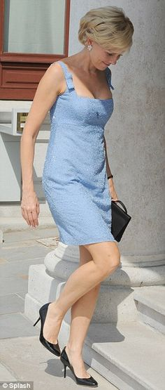 Not exactly the same: Naomi Watts wore her blue summer dress with black heels and a matching bag.