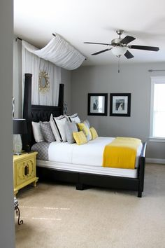 Loving the curtains draped behind the bed, and the grey and yellow.