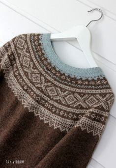 Lovely soft Norwegian sweater. I like the lacy pattern.